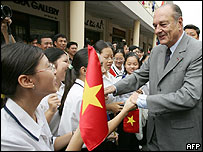 French President Jacques Chirac shakes hands with young Vietnamese, Hanoi - 7/10/04