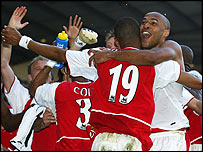 Arsenal celebrate winning the title at White Hart Lane