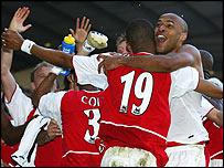 Arsenal celebrate winning the title at White Hart Lane