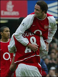 Edu is congratulated after scoring against Chelsea