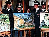 Italian police with three paintings recovered in 1999