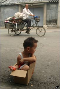 A child in a cardboard box in Beijing
