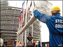 Polish worker unloads new flagpole outside Strasbourg European Parliament building