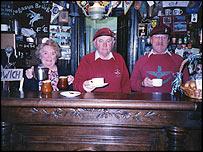 Gordon Newman (centre) at the Pegasus Cafe at Pegasus Bridge