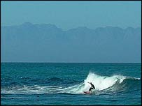 A surfer on Muizenberg beach