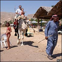Israeli tourists and Bedouin camel owner in Taba