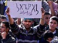 An Egyptian student carries a placard in Hebrew and Arabic saying No Israel