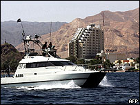 Israeli navy vessels with the Taba Hilton in the background