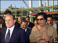 Italian Prime Minister Silvio Berlusconi and Libya's Colonel Muammar Gaddafi at Mellitah gas works in October 2004