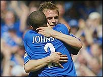Goalscorer Jesper Gronkjaer is congratulated by Glen Johnson