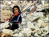 A Palestinian girl among the rubble of a destroyed home, Rafah
