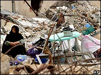 A Palestinian woman among the rubble of a destroyed house in Rafa, 15 May 2004