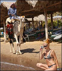 Camel owner and Israeli tourist in Sinai in September
