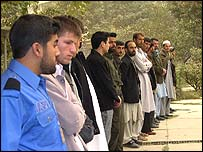 Men queue to vote at Abdul Hadi Dai school in Macrorayon, Kabul