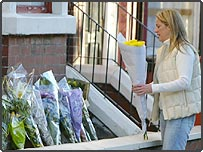 Flowers are laid outside the Bigley family home in Liverpool