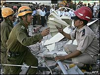 Israeli and Egyptian rescue teams at the scene of the Taba blast