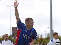 Barry Wilson celebrates as his goal secures the Division One title