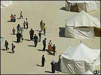 Palestinians at tents in the Rafah area