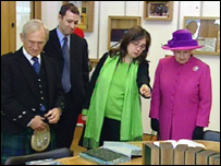 Donald Dewar's son and daughter show the Queen and Presiding Officer George Reid  around the library