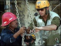 Egyptian and Israeli rescuers work together at the Taba blast site