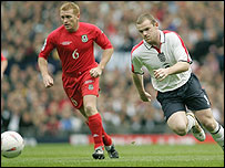 Wayne Rooney takes on Mark Pembridge