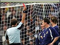 McFadden (partially hidden) is shown the red card