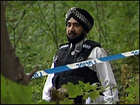 Officer searches woods