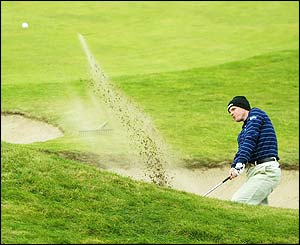 Luke Donald plays out of the greenside bunker