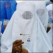 A woman votes in Shiberghan