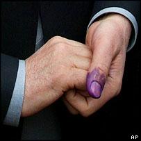 President Karzai's thumb
