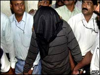 A Bombay gangster arrives in court