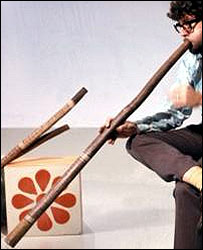 Man playing a didgeridoo