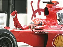 Michael Schumacher celebrates a record 13th win in a season