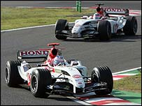 Jenson Button leads Takuma Sato on their way to third and fourth places in Japan