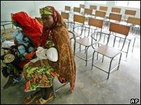 Women wait to have their children immunised