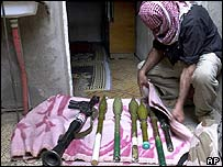 A militiaman collects his weapons in Sadr City.