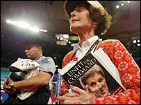 A woman holds a book attacking John Kerry at the Republican convention on 30 August