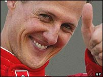 Michael Schumacher celebrates victory in Japan