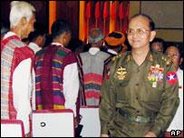 Lt-Gen. Thein Sein walks past ethnic delegates at the National Convention