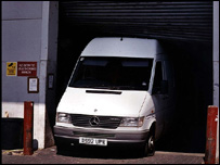 A white Transit van smashed into warehouse doors