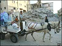 A horse-drawn cart makes its way out of Rafah refugee camp on Monday