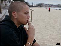 Finnish tourist Jani Pasanen smokes a cigarette on Sydney's Manly Beach