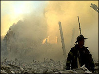 A New York firefighter stands among the wreckage of the World Trade Center