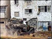 An Israeli army bulldozer in operation in Rafah refugee camp