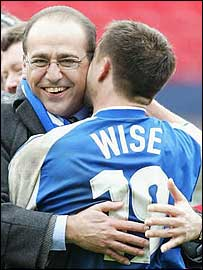 Theo Paphitis (left) embraces player-manager Dennis Wise after their semi-final win
