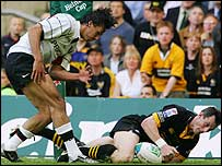 Rob Howley slips past Clement Poitrenaud to score the winning try in the Heineken Cup final