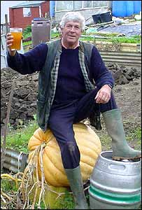 Terry Walton sitting on the pumpkin