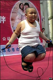 Seven-year-old boy at fat people's party in northeastern city of Shenyang