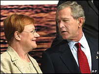 Finnish President Tarja Halonen and US President George W Bush at a NATO summit in Istanbul earlier this year