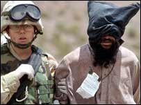 US forces with a suspected Taleban member in Afghanistan
